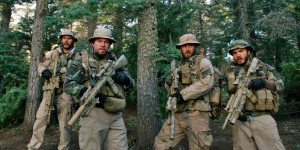 "This photo released by Universal Pictures shows, from left, Taylor Kitsch, as Michael Murphy, Mark Wahlberg as Marcus Luttrell, Ben Foster as Matt ""Axe"" Axelson, and Emile Hirsch as Danny Dietz in a scene from the film, ""Lone Survivor."
